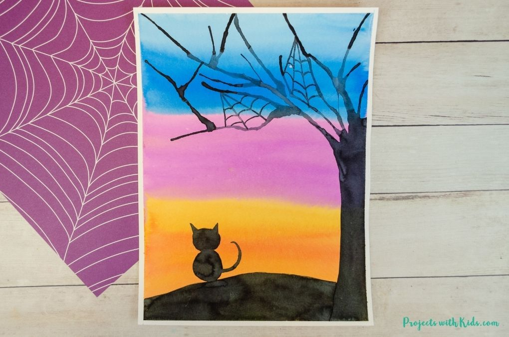 Halloween silhouette art using watercolors and blow painting with straws