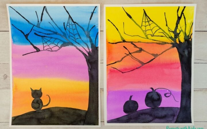 Halloween silhouette art project for kids using watercolors and blow painting with straws