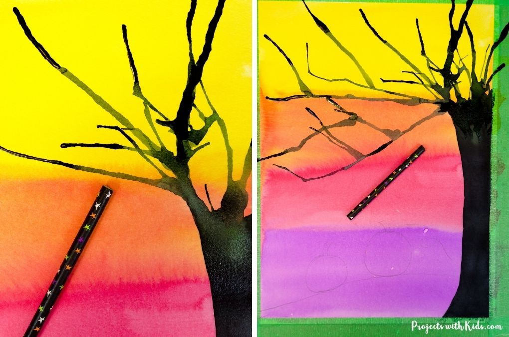 Using a straw for blow painting to create tree branches