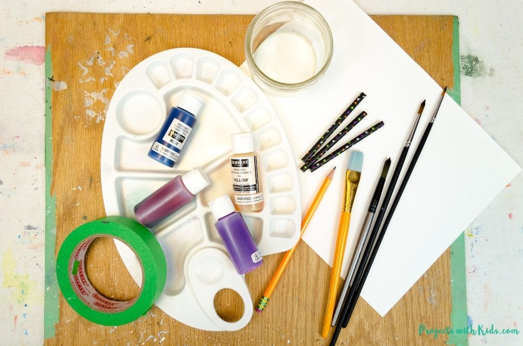 Supplies to make Halloween art with kids using watercolors