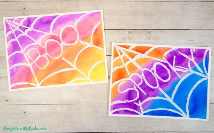 Spider web art project for kids to make using a watercolor resist technique