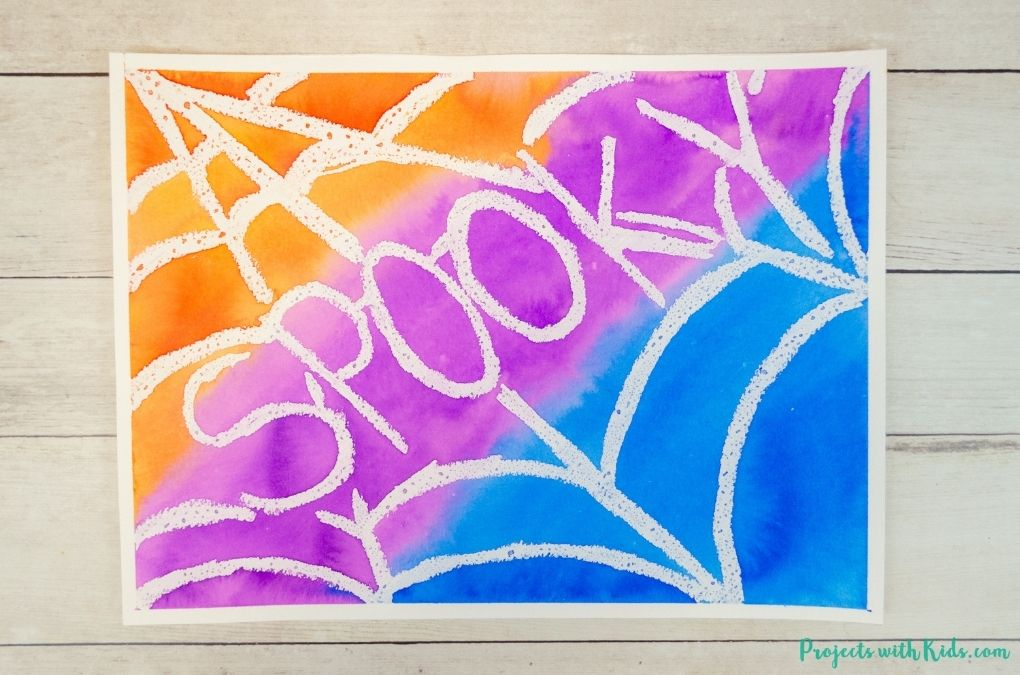 Spider web art project with Halloween words and watercolors