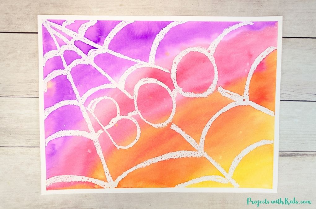 Spider web art project using watercolors and an oil resist technique.