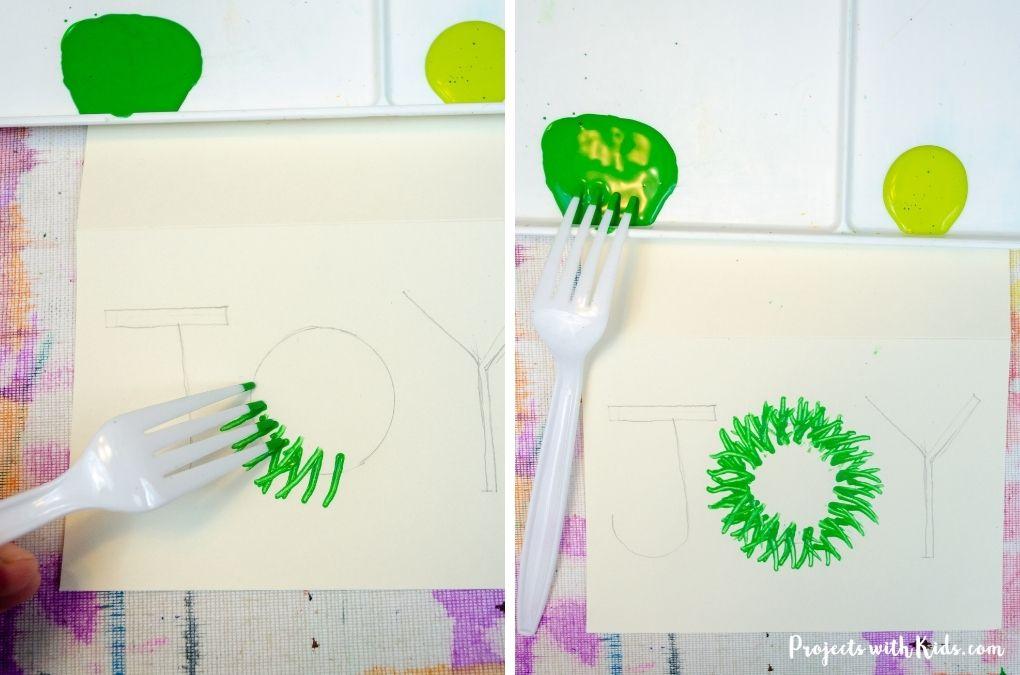 Using a fork to paint a Christmas wreath for a handmade card idea.