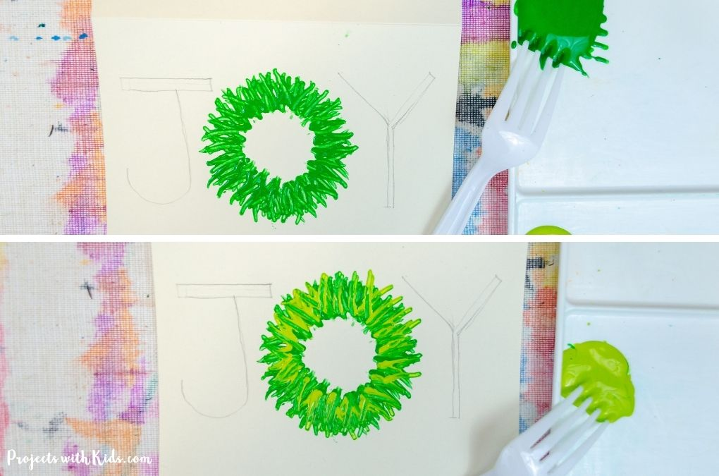 Painting a wreath with a fork and acrylic paint.