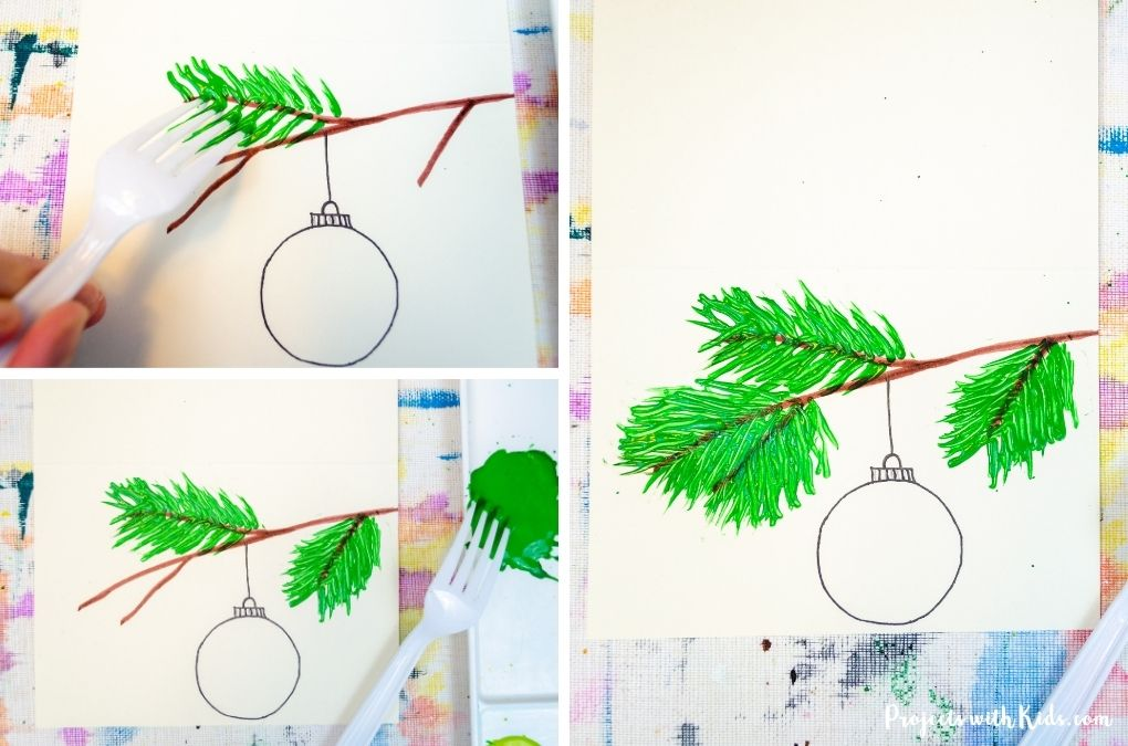 Using acrylic paint and a fork to paint a Christmas tree branch