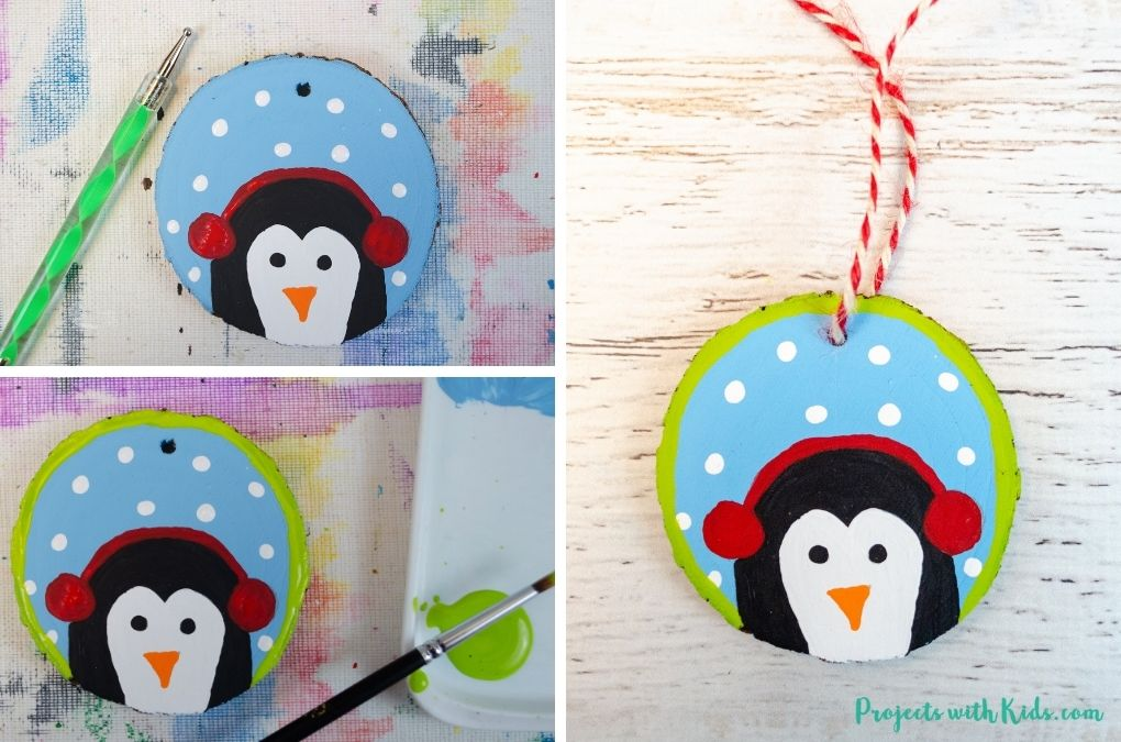 Painting snow and a border on wood slice penguin ornaments.
