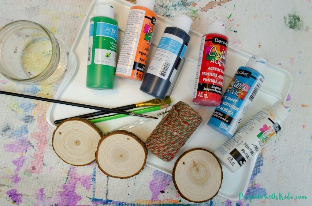 Supplies needed to make wood slice Christmas ornaments