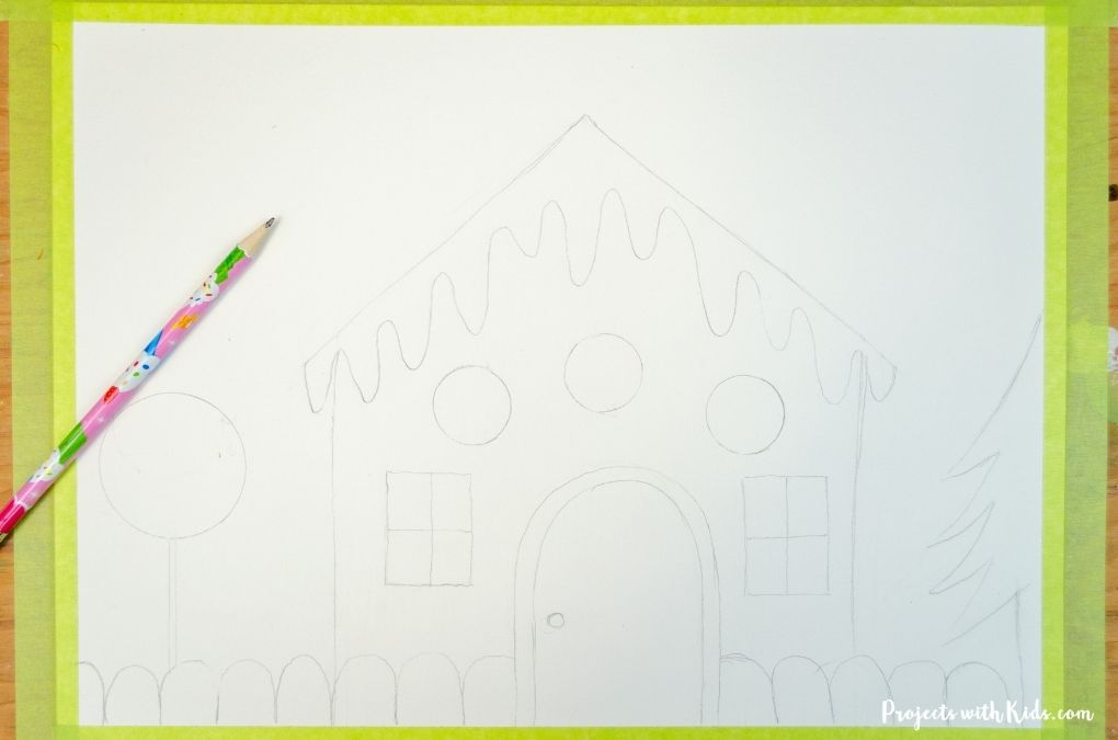 Drawing a gingerbread house for an art project.