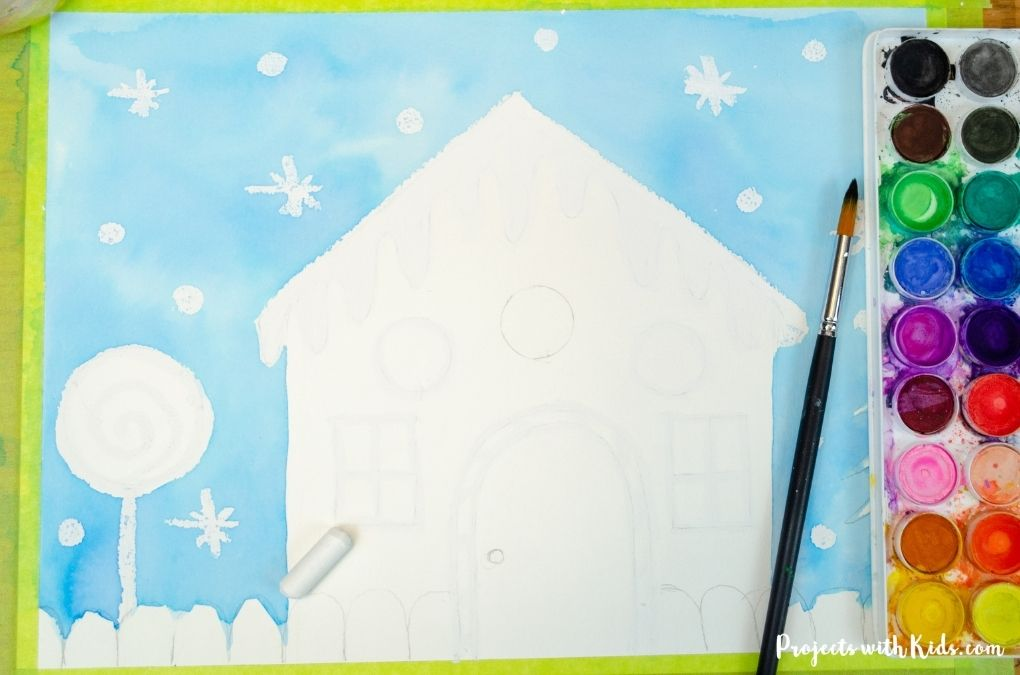 Using a watercolor resist technique for a gingerbread painting.