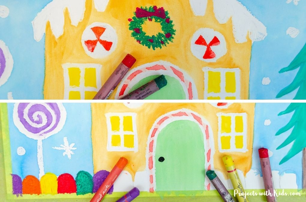 Drawing a wreath and gumdrops onto a gingerbread painting.