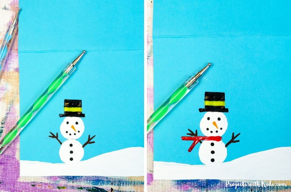 Adding detail to a cork printed snowman using a dotting tool.