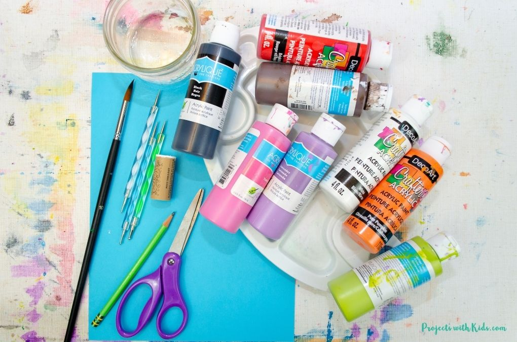 Acrylic painting supplies to make a snowman card.