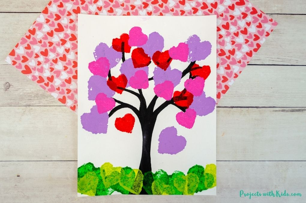 Heart tree painting made with heart sponge prints valentine's day art project for kids