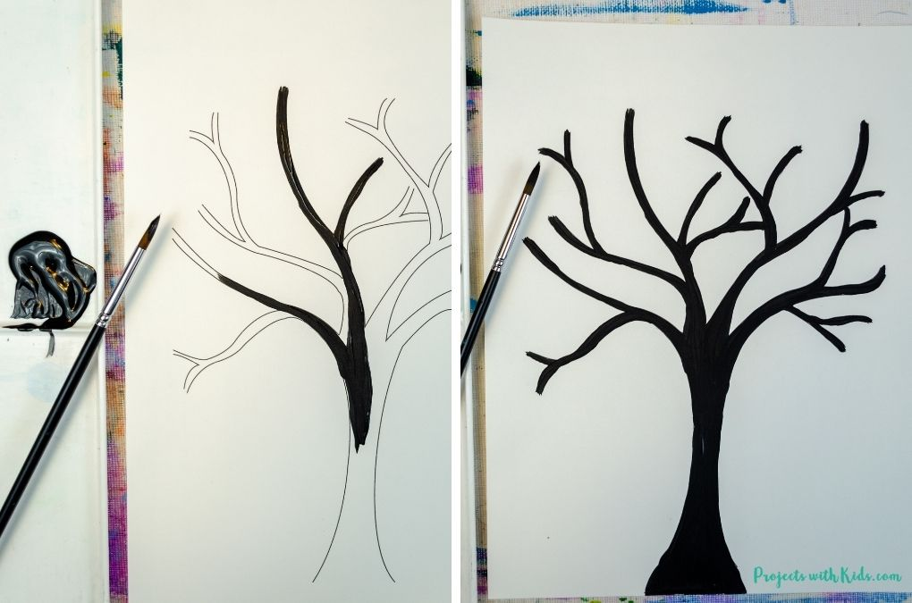 Painting tree branches with black acrylic paint.