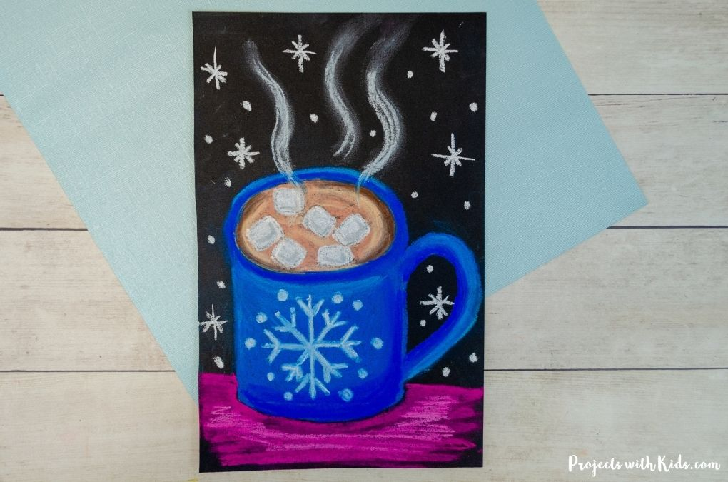 Chalk pastel hot chocolate winter art project for kids to make.