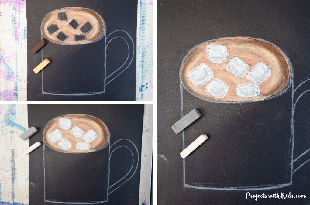 Coloring in marshmallows in a mug of hot chocolate with chalk pastels.