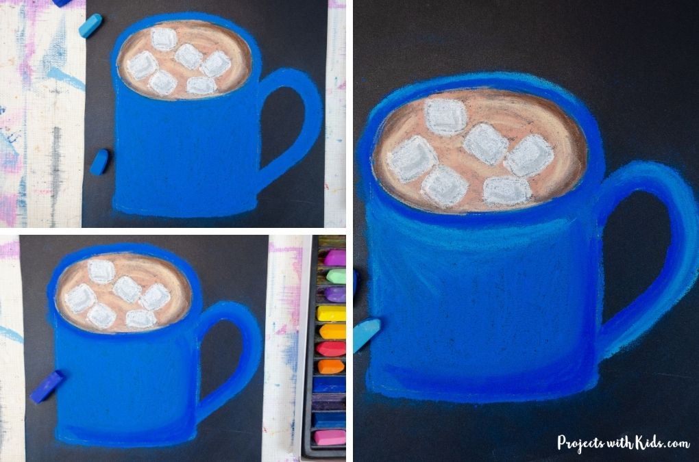 Coloring a mug of hot chocolate blue with chalk pastels.