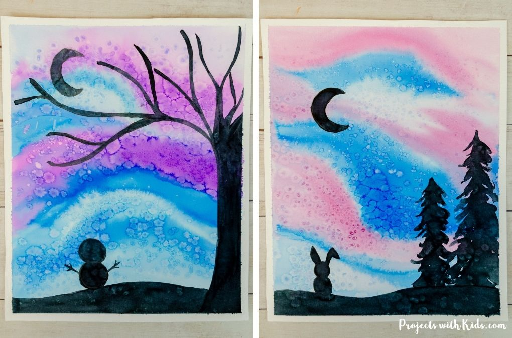 Watercolor winter silhouette art project for kids to make.