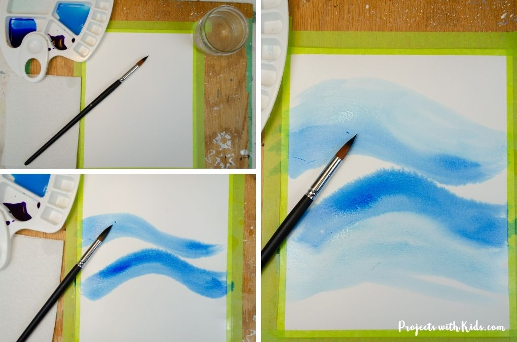 Painting with blue watercolor paint.