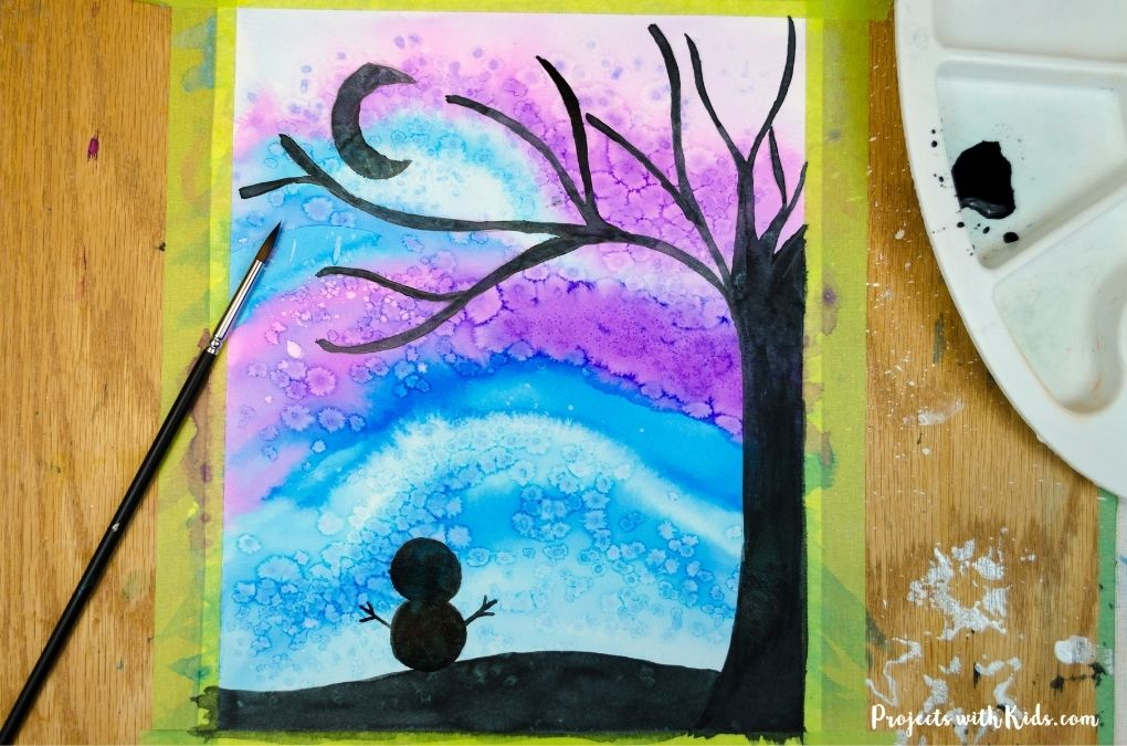 Blue and purple watercolor sky with a winter tree and snowman.