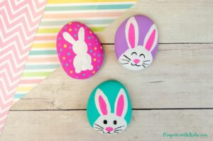 Bunny painted rocks spring or Easter craft idea for kids.