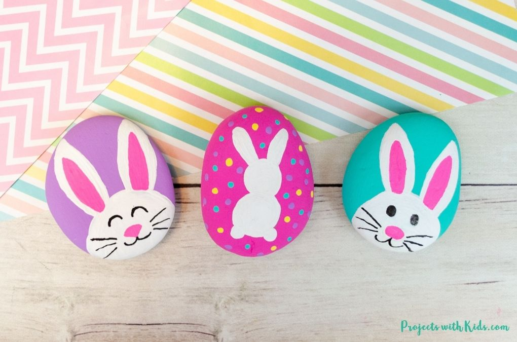 Easter bunny painted rocks for kids to make using paint pens and acrylic paint.
