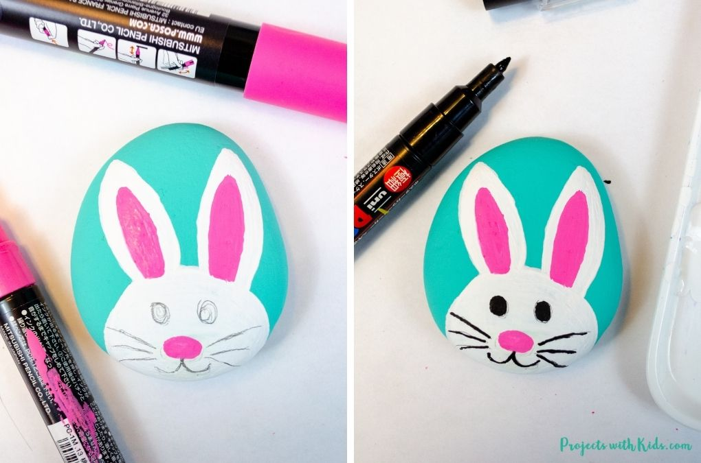 Using a paint pen to paint in a bunny face.