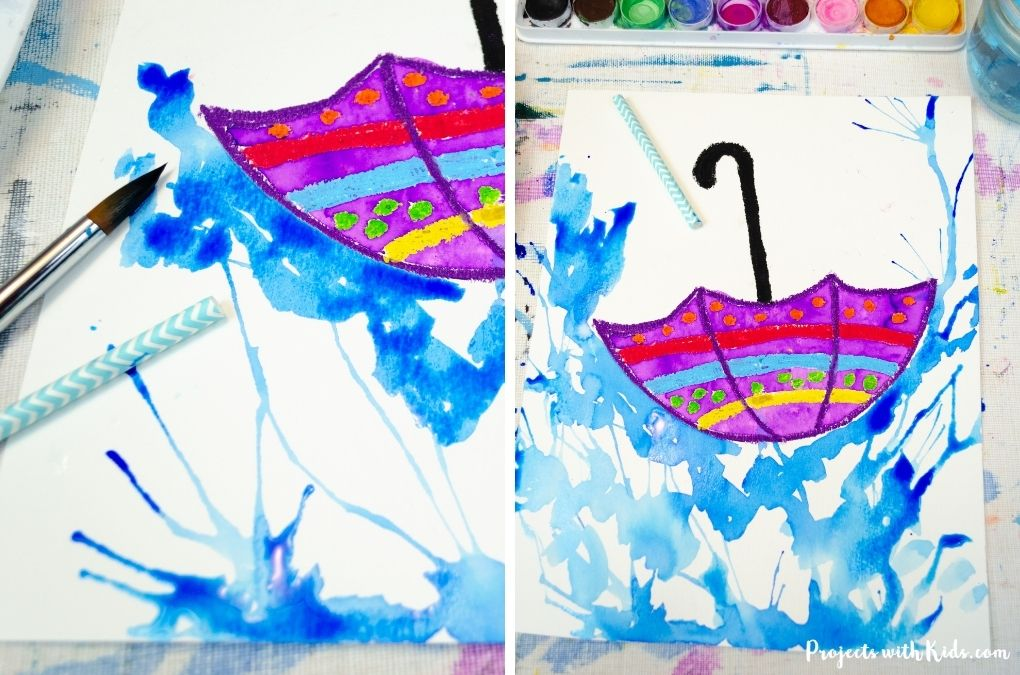 Blow painting rain with watercolors and a straw.