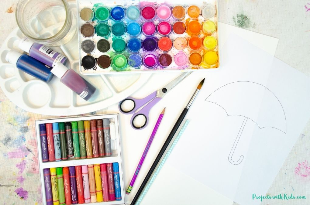 Watercolor painting supplies with printable umbrella template.