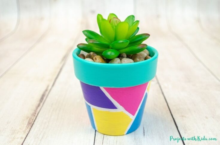 Geometric painted flower pots with fake succulent tween and kid craft idea