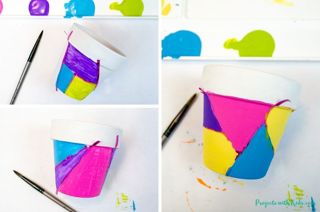 Painting on a mini terra cotta flower pot with acrylic paints.