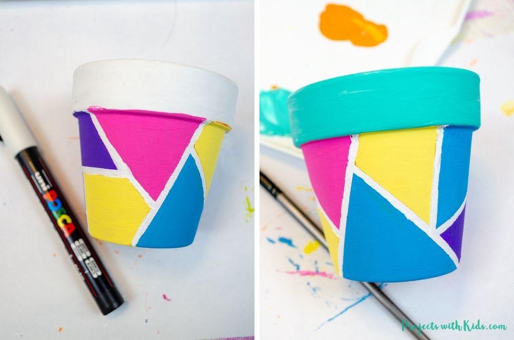 Painting on a mini terra cotta pot.