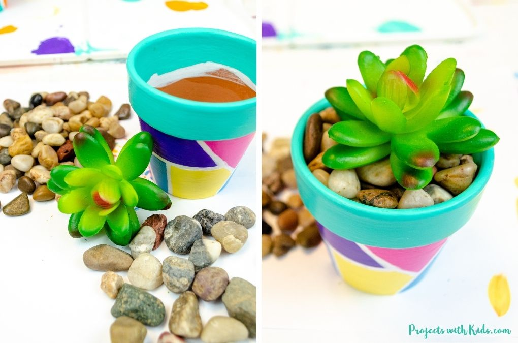 Putting rocks and a fake succulent into a painted flower pot.