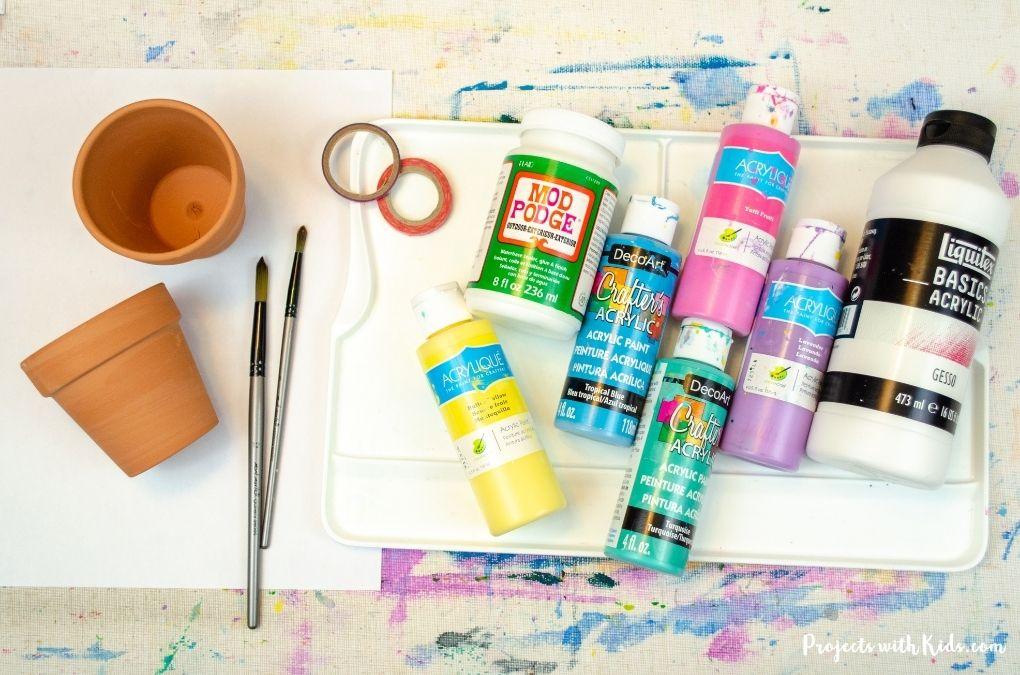 Supplies to paint on mini terra cotta flower pots