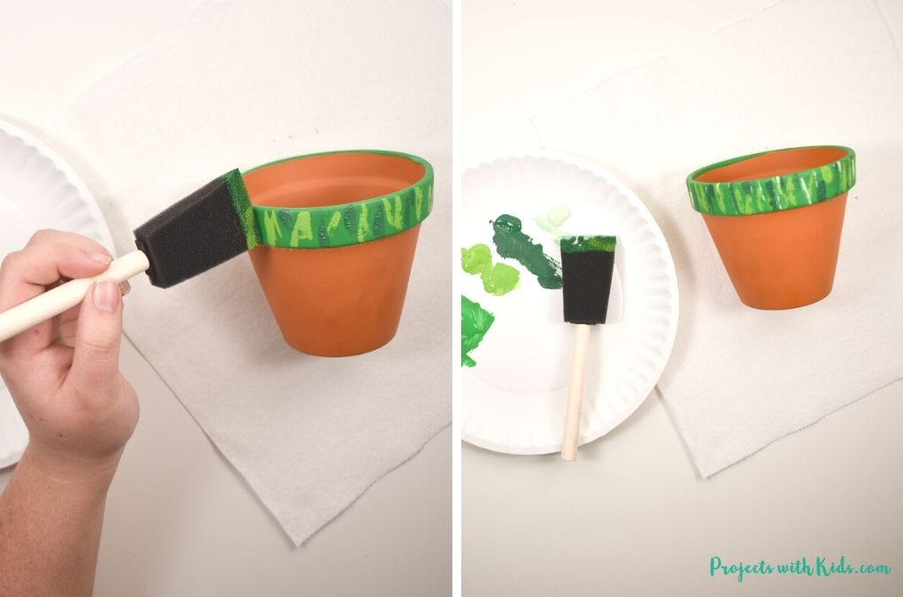 Painting different shades of green on a terra cotta pot