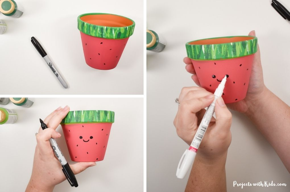 Drawing a face on a watermelon painted pot