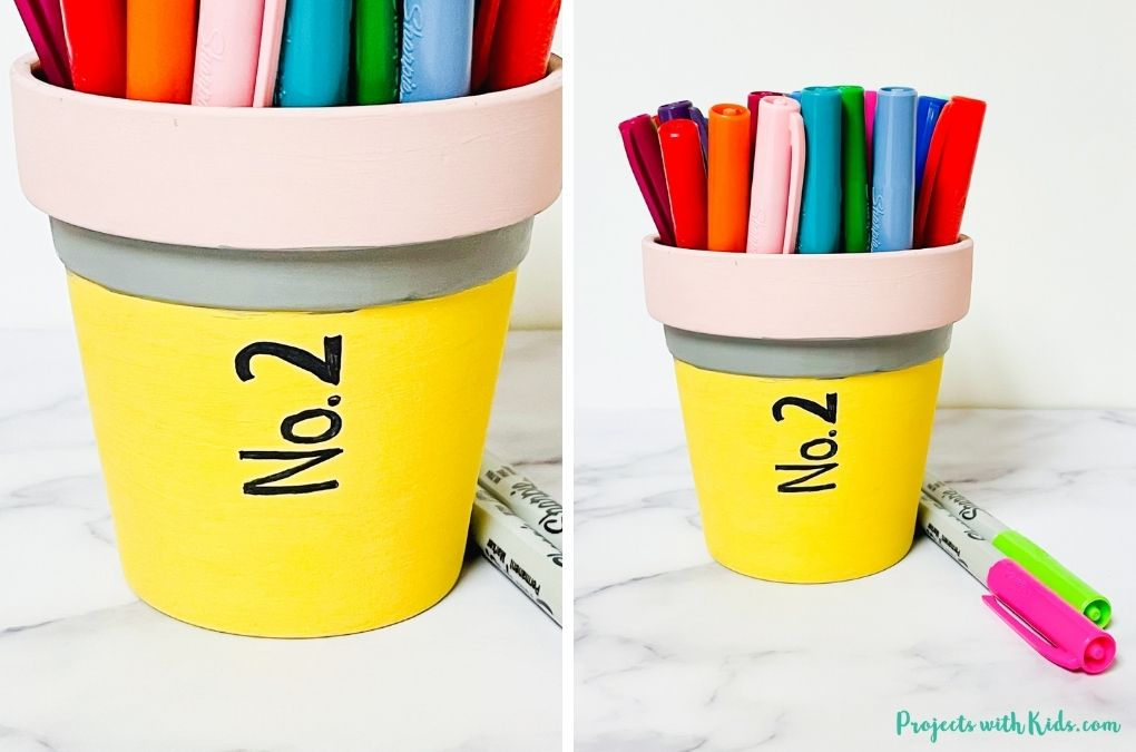 pencil painted flower pot filled with markers