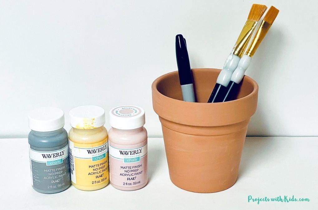 acrylic paint, terra cotta pot, paintbrush and sharpie