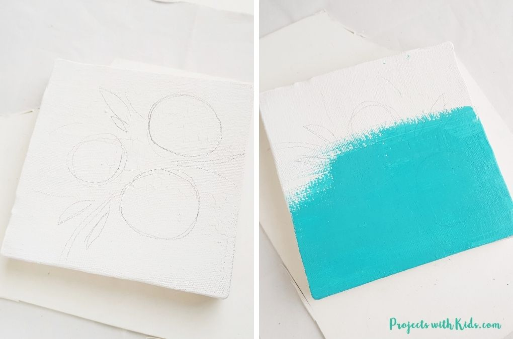 Painting a canvas with blue acrylic paint.