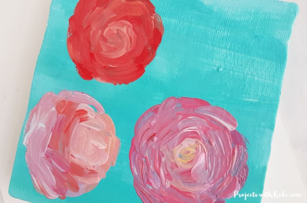 Finishing painting swirly pink roses for a tween and teen art project idea