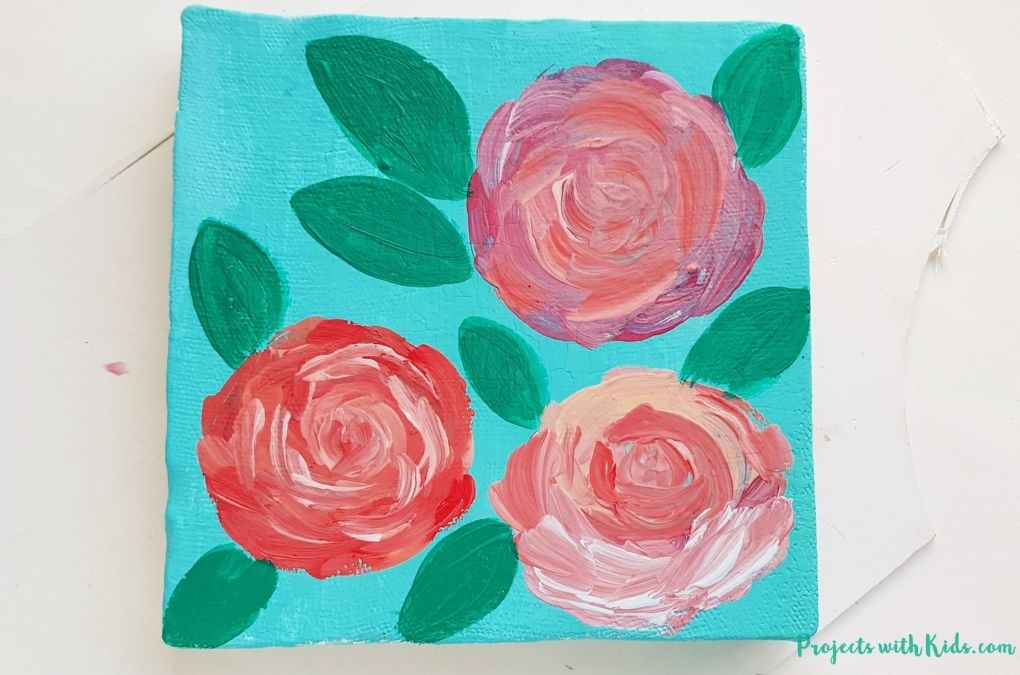 Painting in green leaves on a rose painting art project tutorial for older kids and tweens
