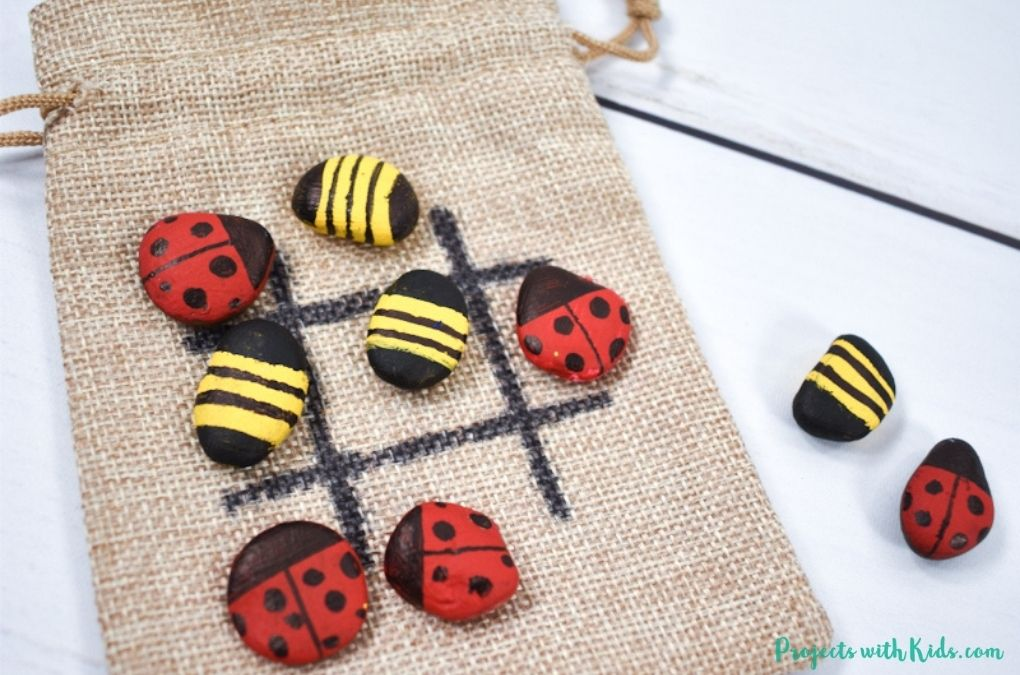 Tic tac toe craft with painted rocks for kids to make