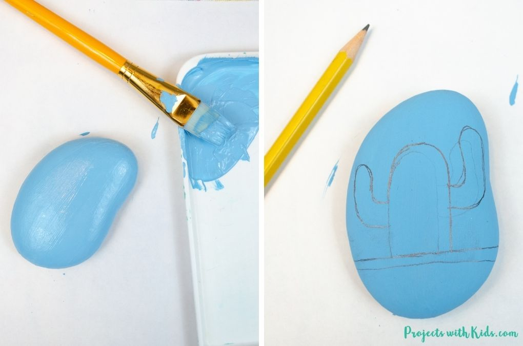 Painting a rock blue and drawing a cactus on in with pencil