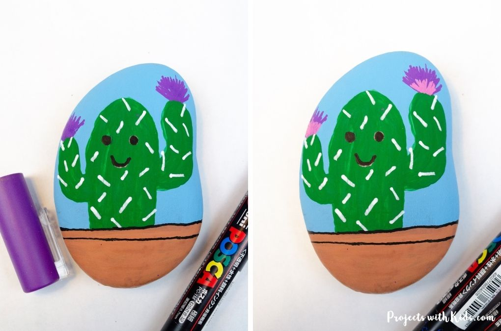 Drawing on flowers on a cactus with a paint pen.