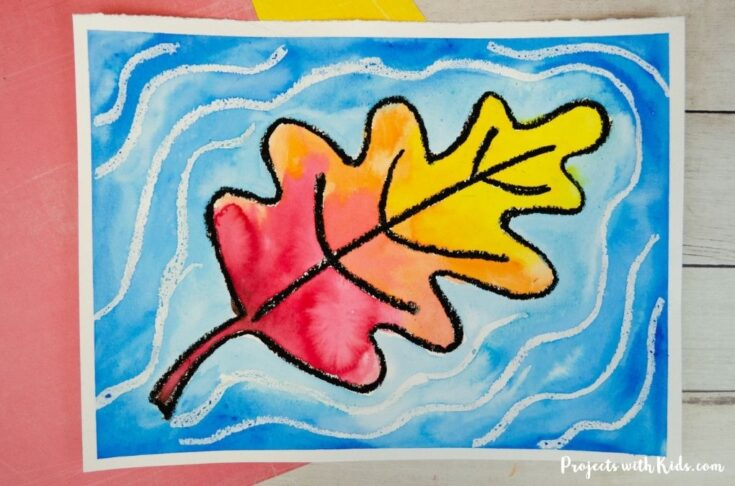 Watercolor fall leaf that looks like it's causing ripples in the water art project idea for kids