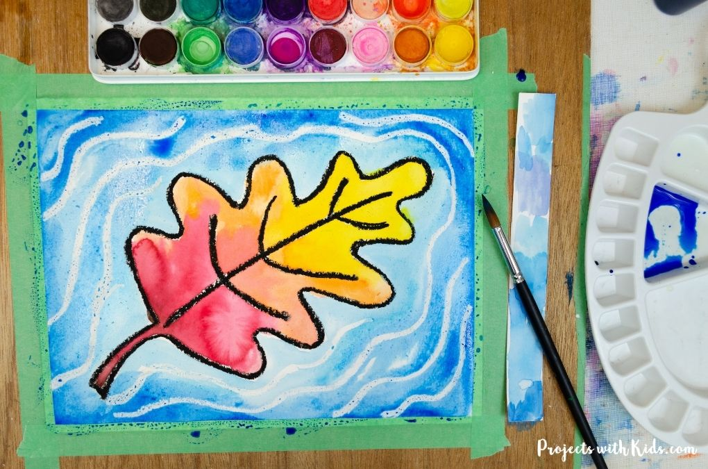 Fall leaf painting using watercolors and oil pastels.