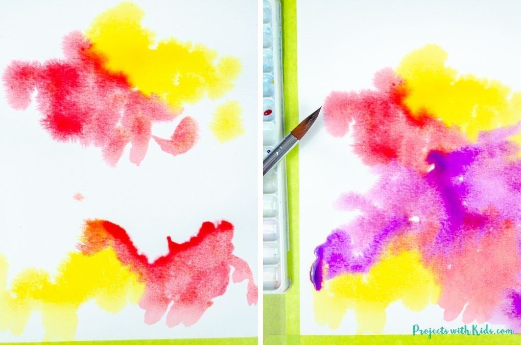 Painting with red, yellow, and purple watercolor paint.